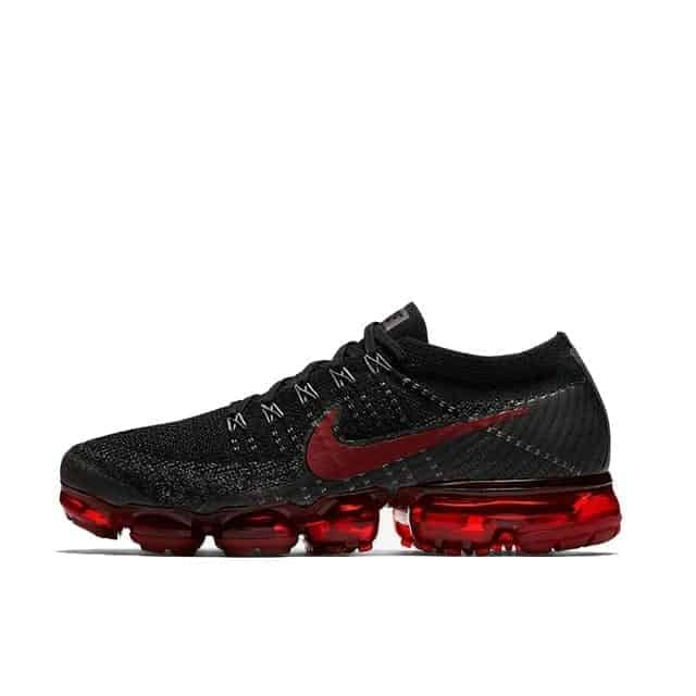 black nike running shoe with red stripes